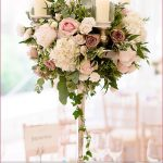 Stunning tall floral centerpieces with candles. Such a romantic centerpiece  idea!