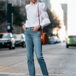 Blonde Woman Wearing Rebecca Taylor White Ruffle Top Relaxed Denim Jeans  Mansur Gavriel Circle Bag White
