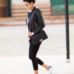 Christine Andrew keeps it casual in this outfit consisting of a leather  jacket, cropped leggings