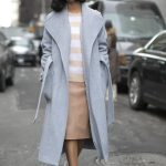 A Street-Style Guide to Wearing an Oversized Overcoat This Fall - chic  longline coat worn with a nude leather skirt and striped shirt