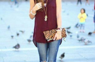 a burgundy top, ripped jeans and ankle booties