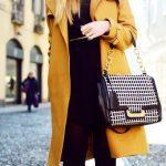 Kristina Bazan is wearing a mustard yellow coat from Zalando