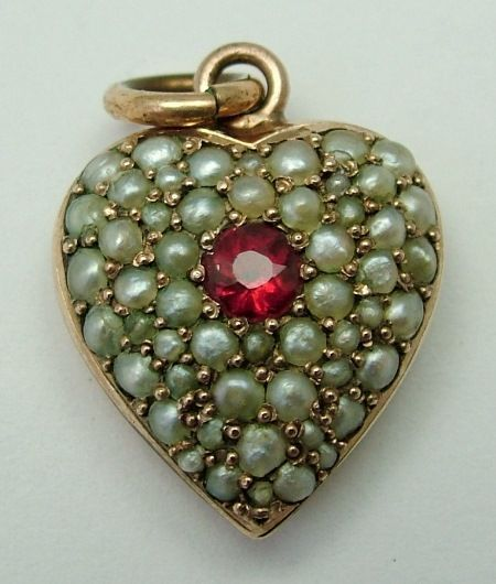 A Victorian c1895 puffy heart charm in, surprisingly, just brass but pave set wi…