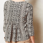 Anthropologie black & white pleated peasant top V-neckline with a button to slig...