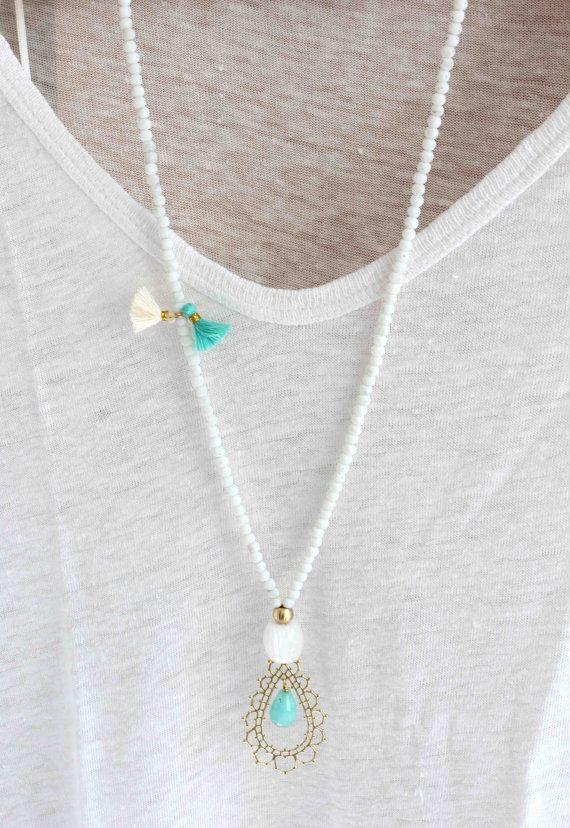 Aqua blue necklace. Gold pendant necklace. Tassel necklace. White beaded necklace. Bohemian necklace