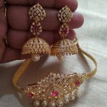Beautiful one gram gold choker studded with white and pink color CZs. Necklace w...