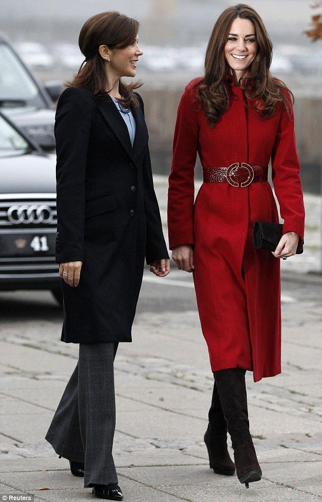 Belting good look: Chic Duchess of Cambridge arrives in Copenhagen for first joint humanitarian mission with Prince William