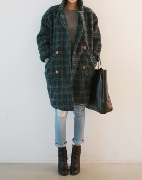 Blue-green tartan coat is worn atop grey colored sweater paired with cuffed ripp…