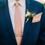 Blue suit with pink tie and tie clip - groom's attire · Rock n Roll Bride