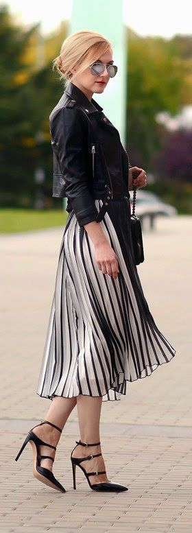 Dress with pleated design flight, moto zip crop jacket, strap fastening pumps