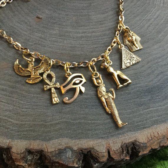 Egyptian necklace, Eye of Ra, Winged Goddess Pyramid, Bastet, gold charm necklace
