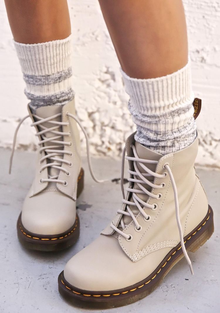 Lace up boots for fall winter fashion outfits.