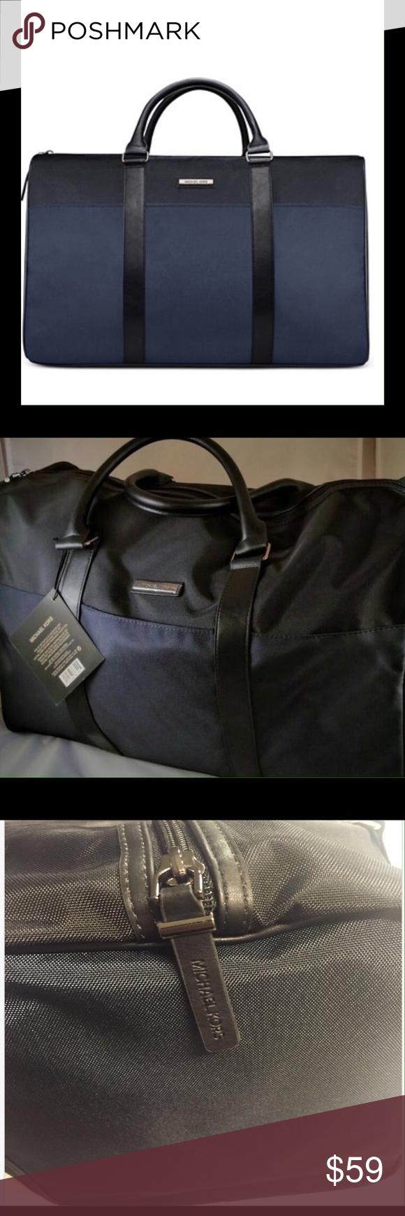 MICHAEL KORS DUFFLE BAG Brand new Michael Kors weekender duffle bag. Features bl…
