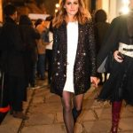 Olivia Palermo wears a white dress, a glitter shiny blazer jacket,...