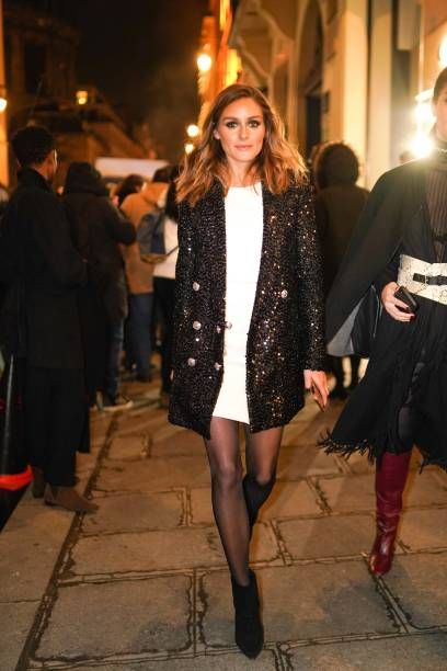 Olivia Palermo wears a white dress, a glitter shiny blazer jacket,…