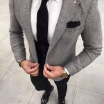 Pair a grey wool coat with black pants if you're going for a neat, stylish look....