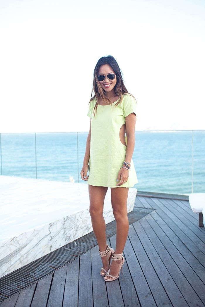 Pastel green dress with side cut-outs looks ladylike and got.