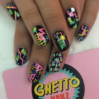 Rewind time, and channel the '80s with some neon print nail art.