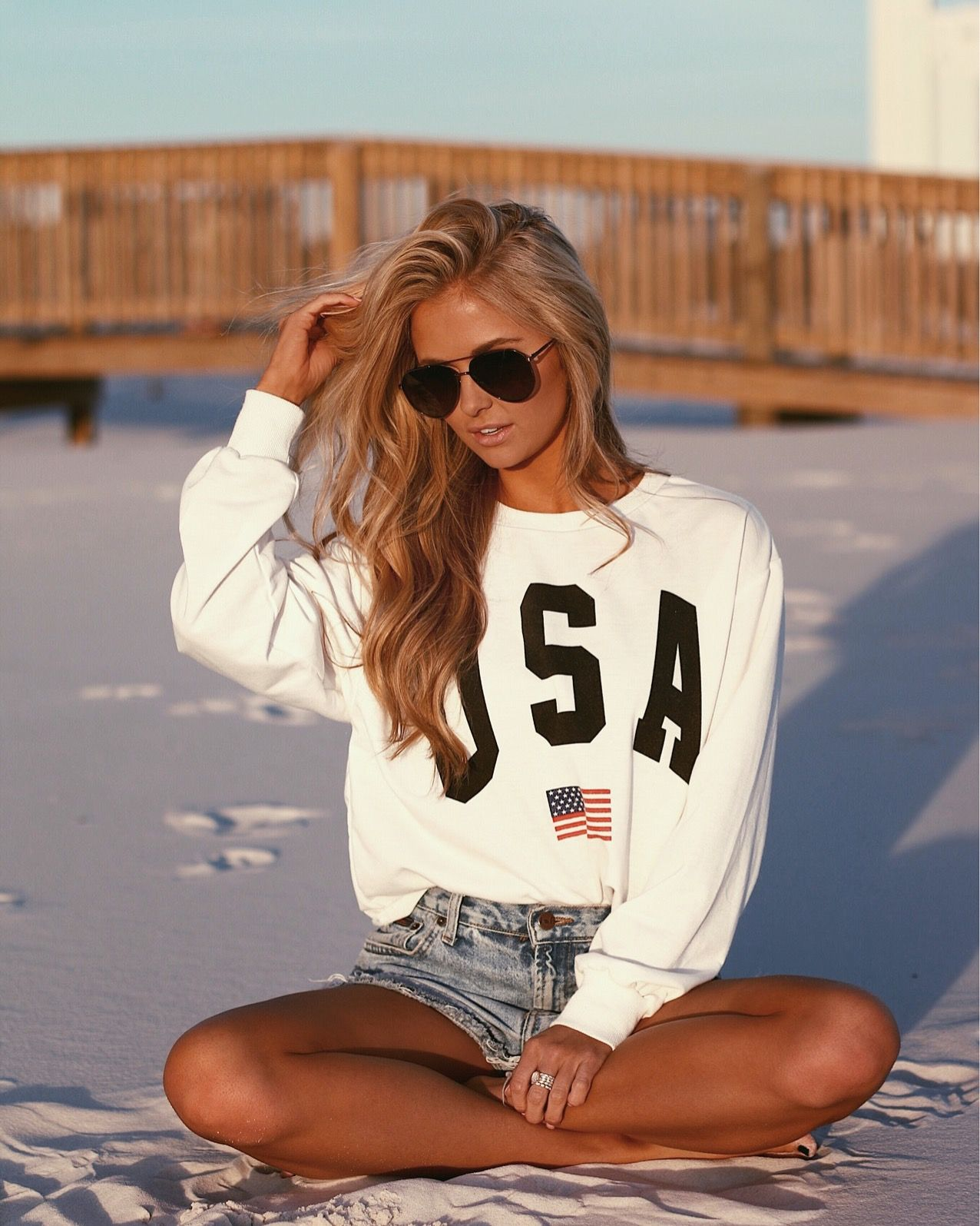 Summer time all American look || distressed denim jeans shorts and USA sweatshir…
