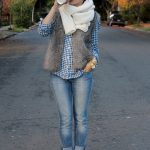 Team a grey fur vest with blue slim jeans to create a chic, glamorous look. Elev...