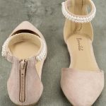 The Kelby Blush Suede Ankle Strap Flats is a classy flat with just the right amo...