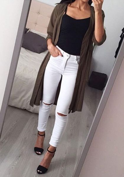This classic white ripped skinny jeans is styled with distressed detailing in th…