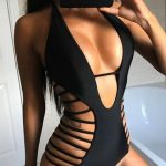 This one piece swimsuit features a plunge neckline, side cutout design, sleevele...