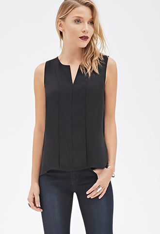 This sleeveless blouse is a workweek dream. It's crafted from an airy chiffon an…