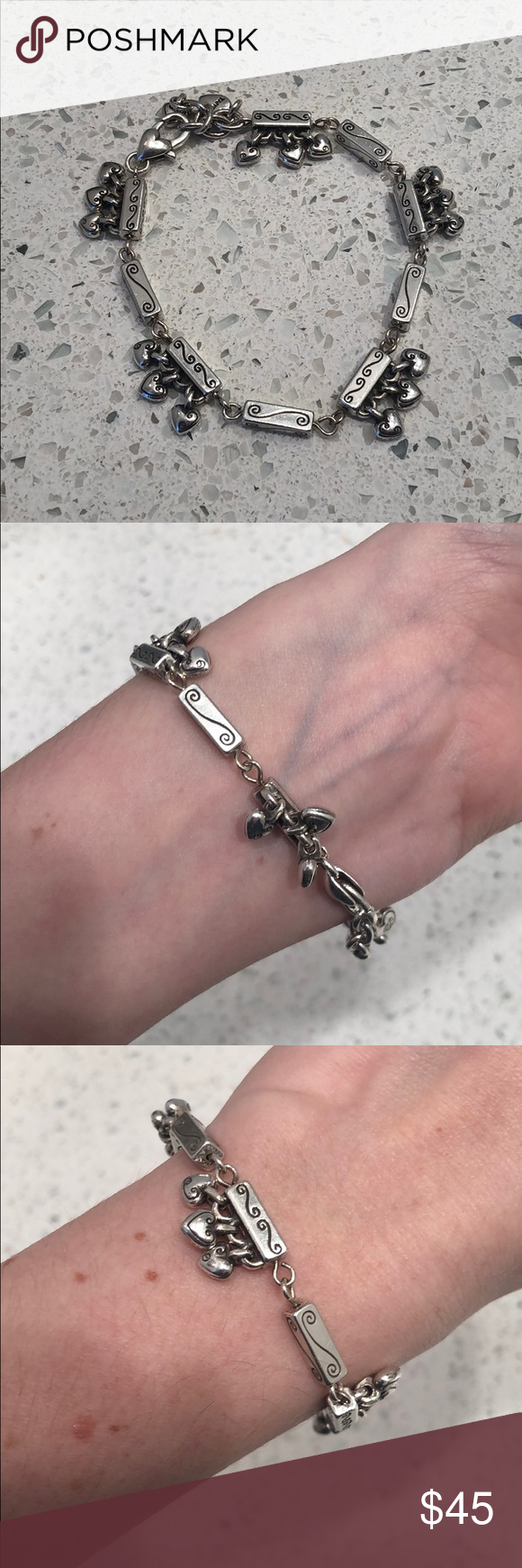 Unique Brighton dangling heart bracelet EUC. 5 sets of 3 dangling hearts.  Measu…