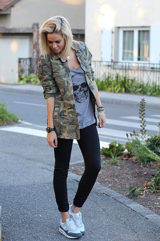 Wear an army green camouflage military jacket and black skinny jeans for a stand…