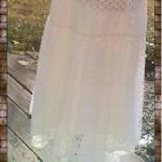 White Lace Asymmetrical Maxi Skirt White lace asymmetrical skirt with open flowe...