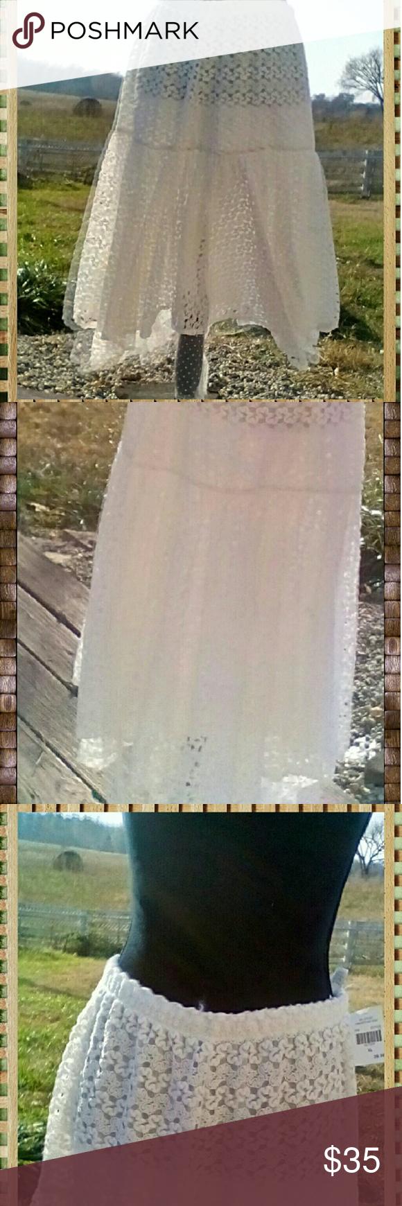 White Lace Asymmetrical Maxi Skirt White lace asymmetrical skirt with open flowe…