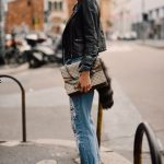 black leather jacket with ripped jeans and marvelous leather loafers