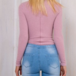 body suit A ribbed texture long sleeve body suit. It is light purple, and stretc...