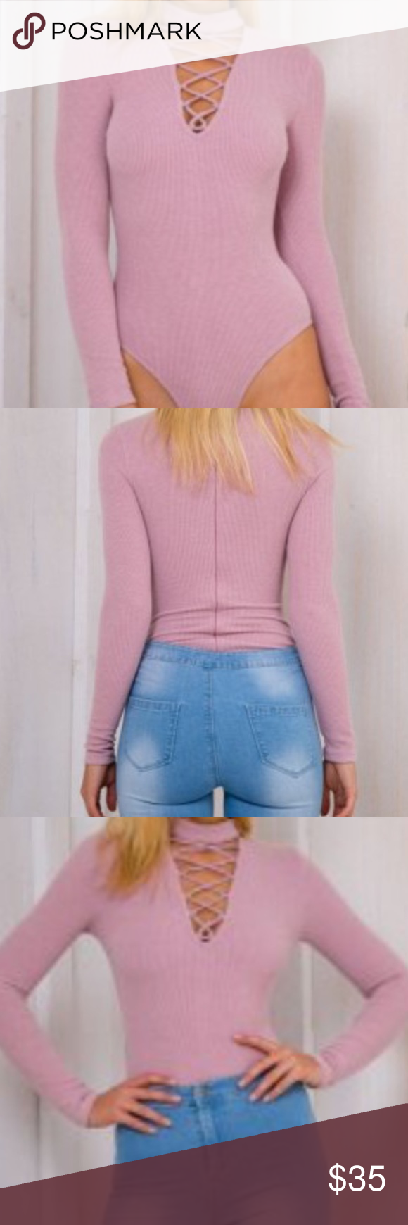 body suit A ribbed texture long sleeve body suit. It is light purple, and stretc…